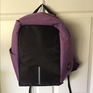 Handbags - TRAVELING BACKPACK. REFLECTIVE. LIGHT PURPLE.